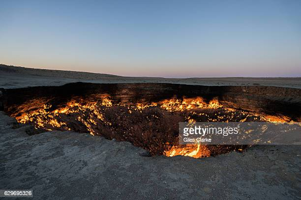 """The """"Door to Hell"""" is a natural gas field in Derweze, Turkmenistan, that collapsed into an underground cavern in 1971, becoming a natural gas crater...."""