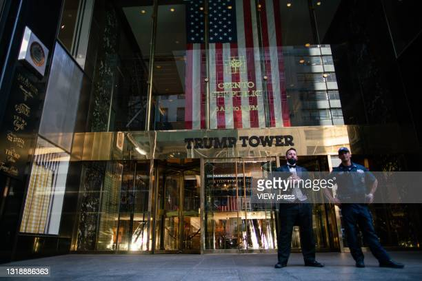 The doorman and a NYPD officer stand guard outside Trump Tower on May 19, 2021 in New York City. New York Attorney General Letitia James is taking...