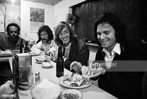 The Doors dine in a Mexican restaurant From right to left Jim Morrison Ray Manzarek John Densmore and Robbie Krieger circa 1970