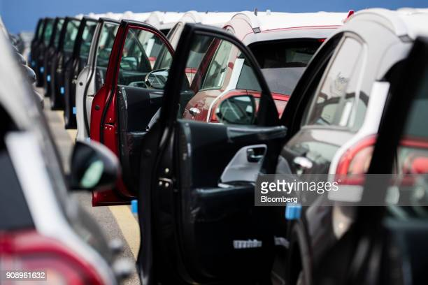 The doors of Kia Motors Corp vehicles sit open as the cars bound for export await shipment at the port of Pyeongtaek in Pyeongtaek South Korea on...