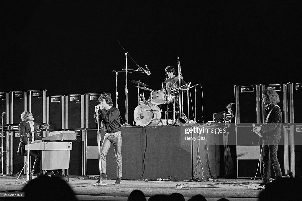 The Doors perform during a concert at the Hollywood Bowl in Los Angeles, California. From left to right: Keyboardist Ray Manzarek, singer Jim Morrison, drummer John Densmore, and guitarist Robby Krieger.