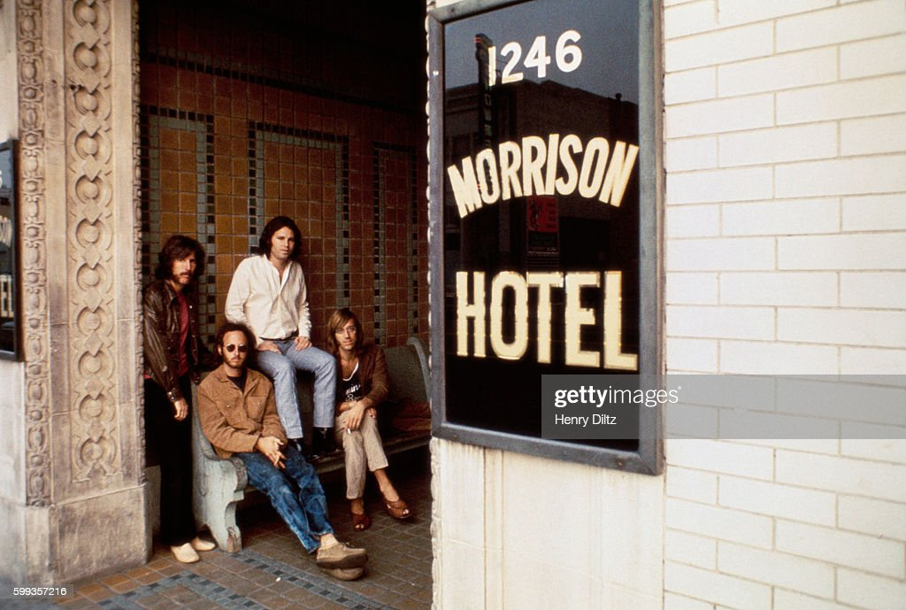 The Doors sit outside the Morrison Hotel in Los Angeles during a photo shoot for their 1970 Morrison Hotel album. Left to right are: John Densmore, drums; Robbie Krieger, guitar; Jim Morrison, vocals; Ray Manzarek, keyboards.