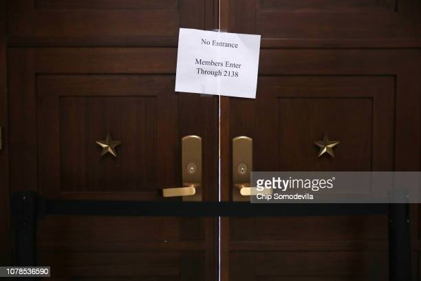 The doors to the House Judiciary Committee hearing room in the Rayburn House Office Building are closed while former Federal Bureau of Investigation...