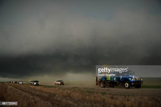 The Doppler on Wheels vehicle arrives on the scene of a supercell thunderstorm during a tornado research mission May 10 2017 in Olustee Oklahoma...