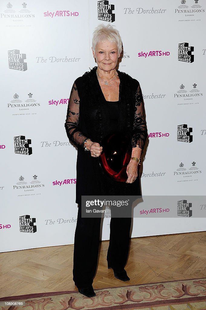 The Dorchester Outstanding Achievement Award Dame Judi Dench poses in the press room at the South Bank Sky Arts Awards at The Dorchester on January 25, 2011 in London, England.