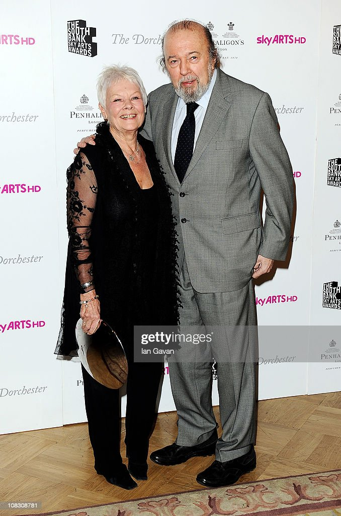 The Dorchester Outstanding Achievement Award Dame Judi Dench poses with Sir Peter Hall in the press room at the South Bank Sky Arts Awards at The Dorchester on January 25, 2011 in London, England.