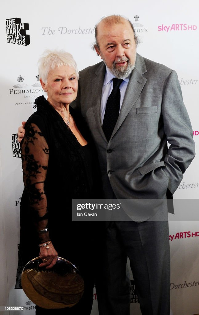 The Dorchester Outstanding Achievement Award winner Dame Judi Dench poses with Sir Peter Hall in the press room at the South Bank Sky Arts Awards at The Dorchester on January 25, 2011 in London, England.