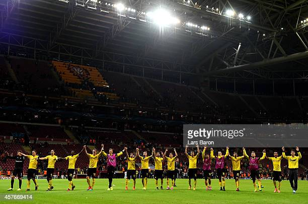 The Dortmund players celebrate their 40 victory during UEFA Champions League Group D match between Galatasaray and Borussia Dortmund at Turk Telekom...