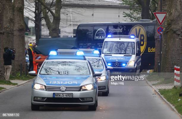 The Dortmund team coach escorted by police arrives for the UEFA Champions League Quarter Final first leg match between Borussia Dortmund and AS...