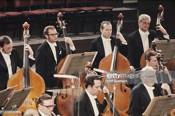 The double bass section of the Vienna Philharmonic Orchestra in performance circa 1975