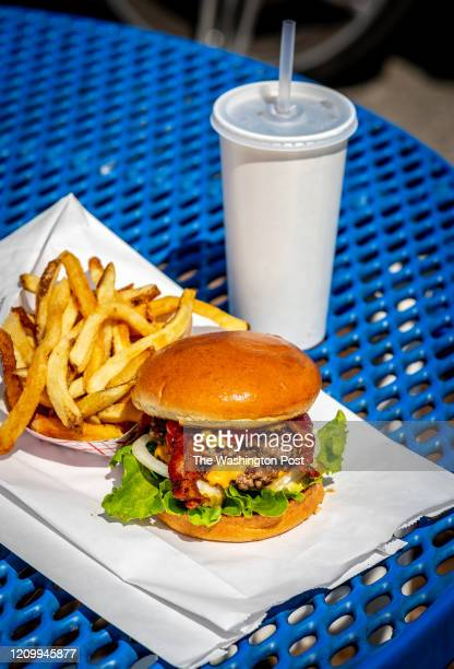 The Double Cavern Burger with Bacon and a side of fresh cut fries at Spelunker's Frozen Custard and Burgers photographed for Casual Dining in Front...