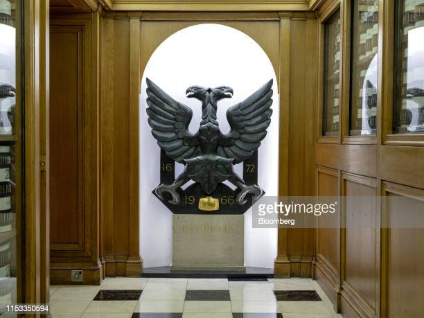 High dynamic range HDR imaging used for photo The double headed eagle part of the Hoare family coat of arms since the early 1700s sits on the wall...