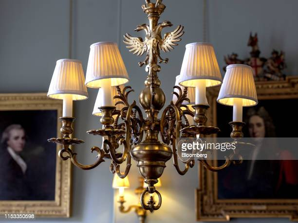 High dynamic range HDR imaging used for photo The double headed eagle part of the Hoare family coat of arms since the early 1700s adorns a chandelier...