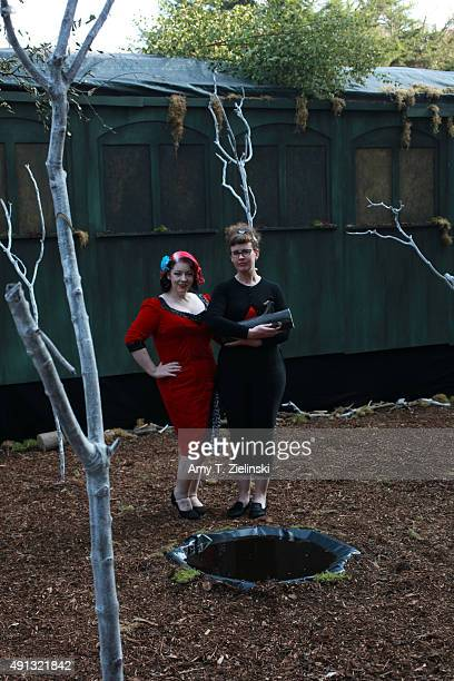 The Double R Club actress Rose Thorne and Jo Gilliver holding a log stand in the recreated set of the forrest near the train car where Laura Palmer...