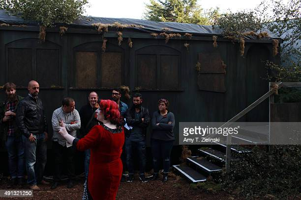 The Double R Club actress Ross Thorne leads festival goers through the recreated set of the forrest to the train car for a reenactment of Laura...