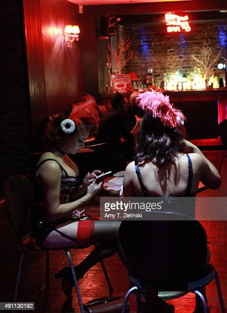 The Double R Club's Louise Holland and Yvonne Holland sit while dressed as characters from OneEyed Jack's a brothel featured in Twin Peaks TV show...