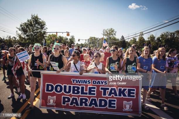 The Double Take Parade begins at Twins Days Festival at Glenn Chamberlin Park on August 3 2019 in Twinsburg Ohio Twins Day celebrates biological...