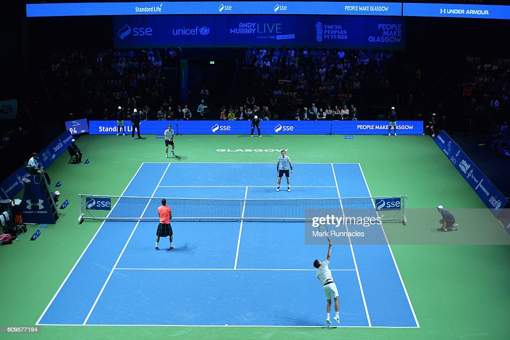 The doubles match between Andy Murray and Jamie Murray of Scotland and Tim Henman of England and Grigor Dimitrov of Bulgaria at Andy Murray Live presented by SSE at the SSE Hydro on September 21, 2016 in Glasgow, Scotland.