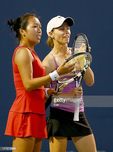 The doubles team of Cara Black of Zimbabwe and Vania King of the USA talk in between serves from the team of Martina Hingis of Switzerland and...