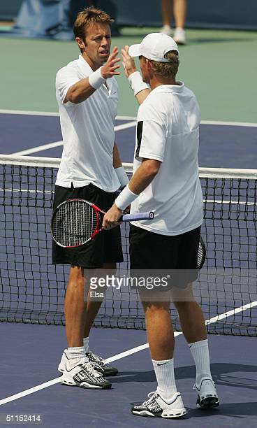 The doubles team of Daniel Nestor of Canada and Mark Knowles of the Bahamas celebrate their win over Jonas Bjorkman of Sweden and Todd Woodbridge of...