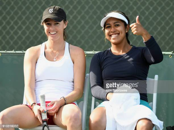The doubles team of Kaitlyn Christian and Sabrina Santamaria are all smiles after defeating Kayla Day and Caroline Dolehide in two set of a...