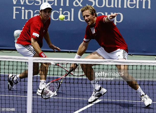 The doubles team of Todd Woodbridge of Australia and Jonas Bjorkman of Sweden return a ball to the team of Mark Knowles of the Bahamas and Daniel...