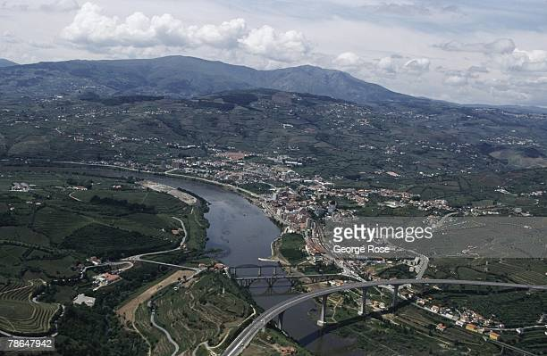The Douro River and the city of Regua are viewed in this 2003 Regua Portugal aerial photo