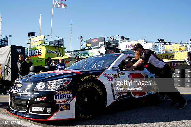 The DOW Chevrolet of Austin Dillon is pushed through the garage area during practice for the NASCAR Sprint Cup Series Sprint Unlimited at Daytona...