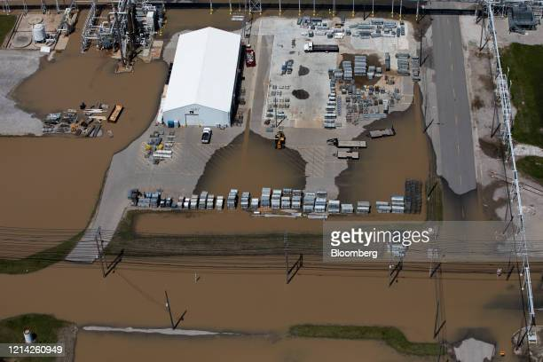 The Dow facility stands surrounded by flood water after dams failed in Midland Michigan US on Wednesday May 20 2020 Two dams failed upstream of Dow...
