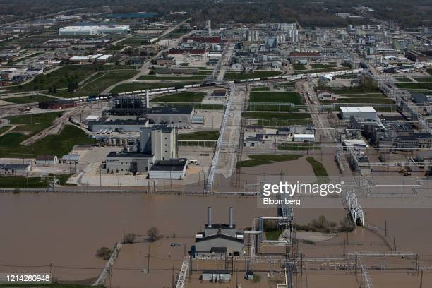 The Dow facility stands surrounded by flooding from the Tittabawassee River in this aerial photographer taken after dams failed in Midland Michigan...