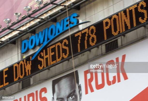 The Dow Jones ticker in Times Square displays news about the stock market in New York US on Monday Sept 29 2008 US stocks plunged and the Standard...