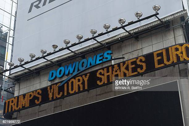 The Dow Jones ticker in Times Square shows news about last night's election results following Donald Trump's presidential win on November 9 2016 in...