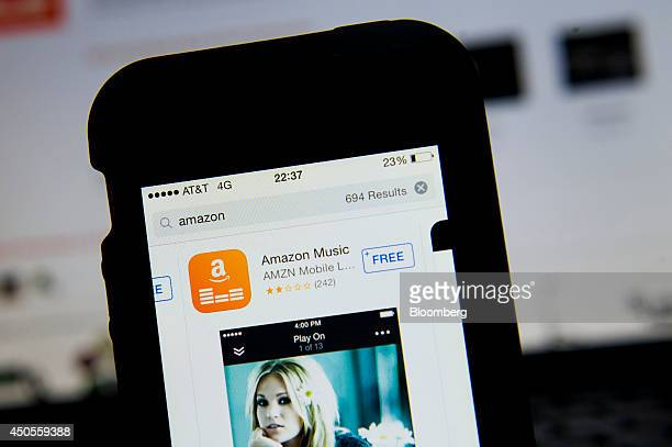 The download interface for the Amazoncom Inc Prime Music mobile app is displayed on an Apple Inc iPhone 5 for a photograph in San Francisco...
