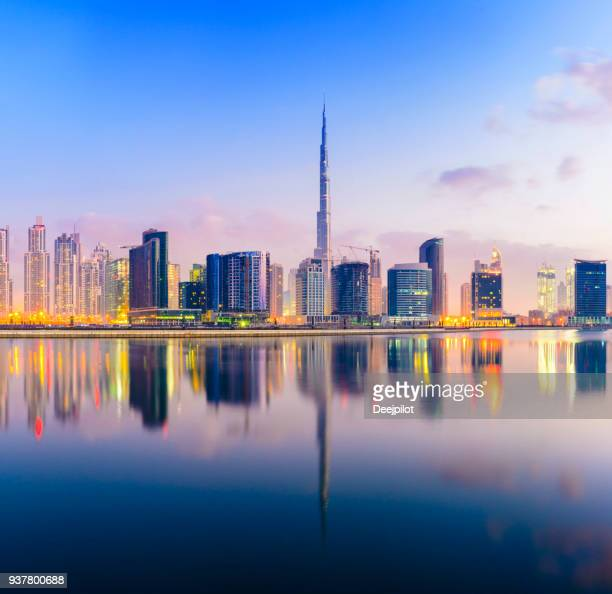 the downtown dubai city skyline at sunset - skyline stock pictures, royalty-free photos & images
