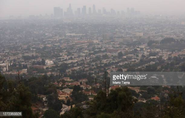 The downtown skyline is partially obscured by smoke from wildfires after sunset on September 13, 2020 in Los Angeles, California. Air quality was...