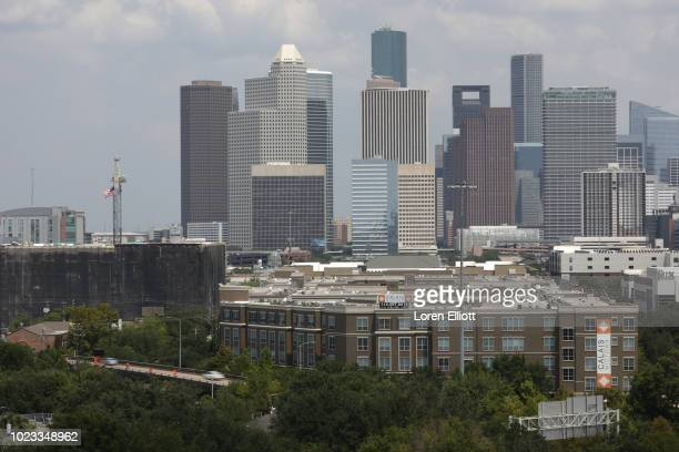 The downtown skyline is pictured on August 25 2018 in Houston Texas August 25 is the oneyear anniversary of when Hurricane Harvey made landfall on...
