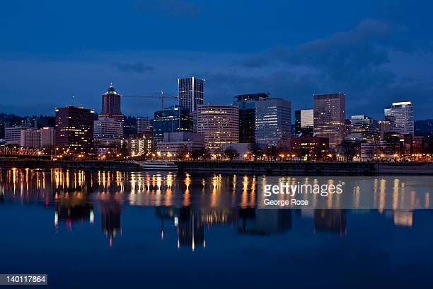 The downtown skyline shimmers in the early morning waters of the Willamette River on February 11 in Portland Oregon Portland has embraced its...