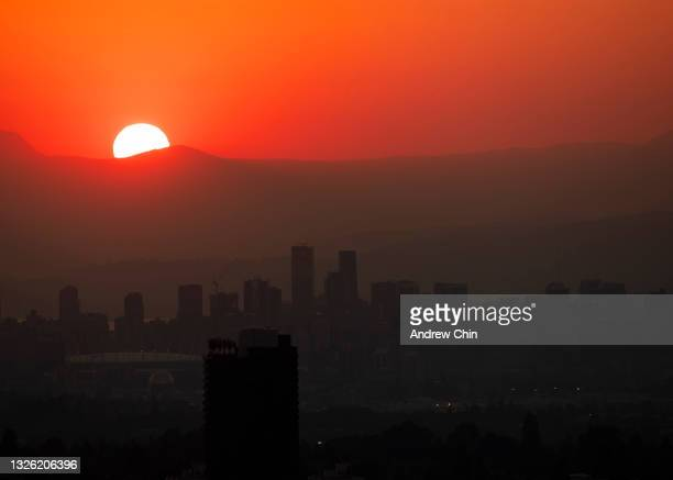 The downtown Vancouver skyline glows red shortly during sunset on June 29, 2021 in Burnaby, British Columbia, Canada. Environment Canada has issued...