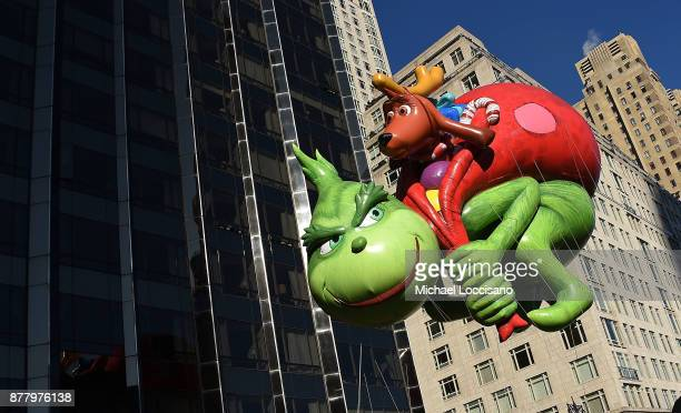 The Dr Seuss Grinch and Max balloon floats down Central Park West and into Columbus Circle during the 91st Annual Macy's Thanksgiving Day Parade on...