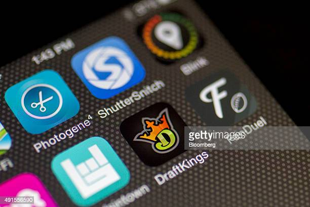 The DraftKings Inc and FanDuel Inc apps are displayed on an Apple Inc iPhone in Washington DC US on Sunday Oct 4 2015 Fantasy sports companies...