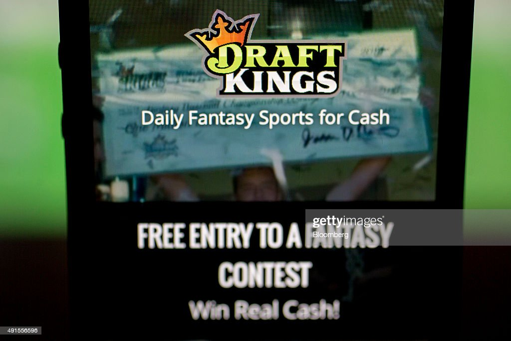 The DraftKings Inc. app is arranged for a photograph on an Apple Inc. iPhone in Washington, D.C., U.S., on Sunday, Oct. 4, 2015. Fantasy sports companies DraftKings Inc. and FanDuel Inc. raised a total of $575 million in July from investors including KKR & Co., 21st Century Fox Inc. and Major League Baseball to attract players to games that pay out millions of dollars in cash prizes in daily contests. Photographer: Andrew Harrer/Bloomberg via Getty Images