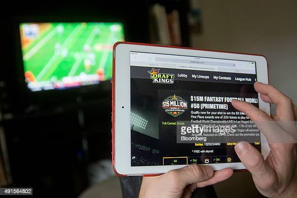 The DraftKings Inc website is arranged for a photograph on an Apple Inc iPad in Washington DC US on Sunday Oct 4 2015 Fantasy sports companies...