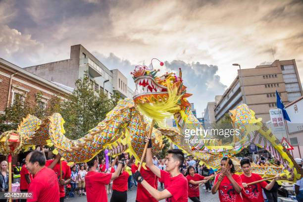 the dragon at the chinese new year celebrations - chinese dragon stock photos and pictures