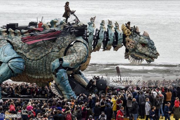 """The """"dragon of Calais"""" by French street art company """"La Machine"""" parades on November 1, 2019 in the northern France city of Calais, on the first day..."""