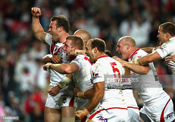 The Dragons celebrate after Ben Creagh of the Dragons scored the winning try during the round eight NRL match between the St George Illawarra Dragons...