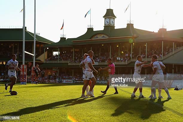 The Dragons celebrate after Matt Cooper of the Dragons scored a try during the round six NRL match between the Wests Tigers and the St George...