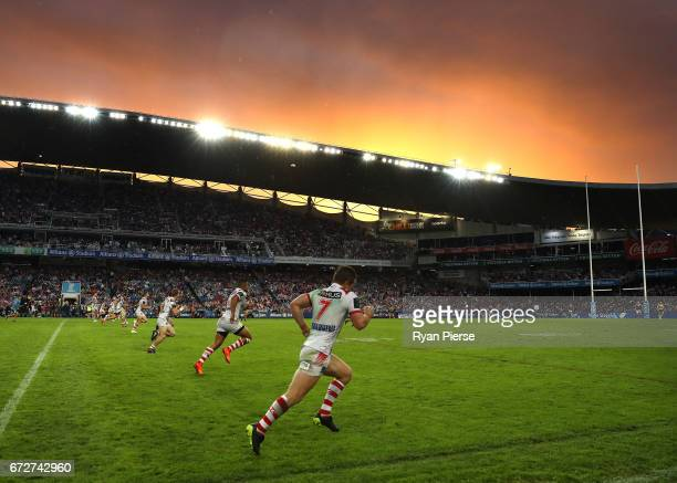 The Dragons kick off after half time at sunset during the round eight NRL match between the Sydney Roosters and the St George Illawarra Dragons at...