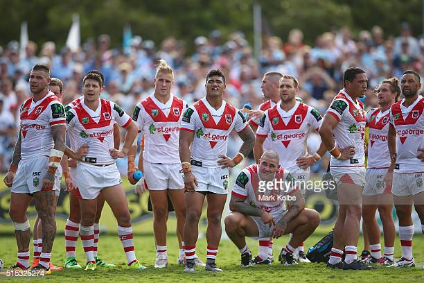 The Dragons looks dejected after a Sharks try during the round two NRL match between the Cronulla Sharks and the St George Illawarra Dragons at Shark...