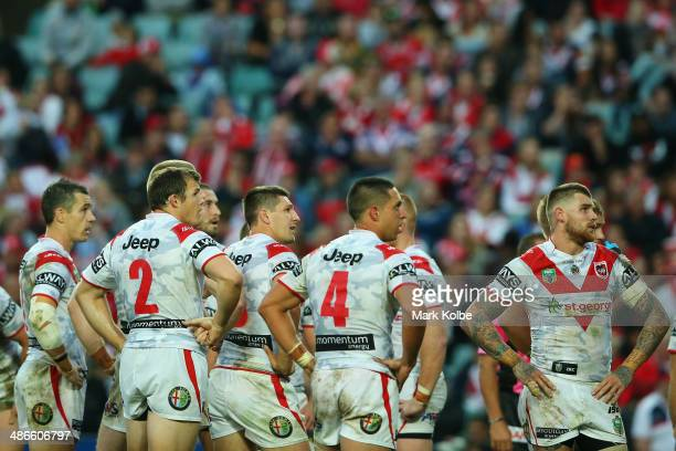 The Dragons players look dejected as they watch a replay of a Roosters try on the big screen during the round 8 NRL match between the St George...