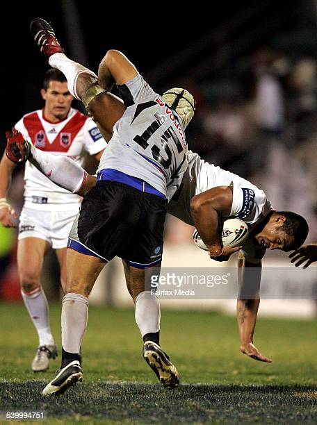 The Dragons' Wes Naiqama is spear tackled during the Round 10 NRL rugby league match between the St George Illawarra Dragons and New Zealand Warriors...